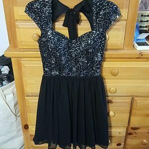 Black cap-sleeve sequin flowy cocktail dress